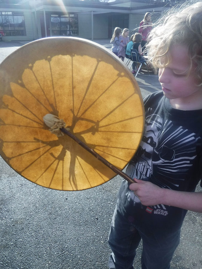 A young drummer plays outside in a drumming session with our District Cultural Advisor, Quentin Harris (Quentin Harris)